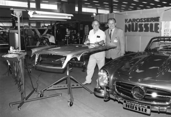 Oskar Flaig working on Mercedes Benz at what looks like the MOtor Sports trade show